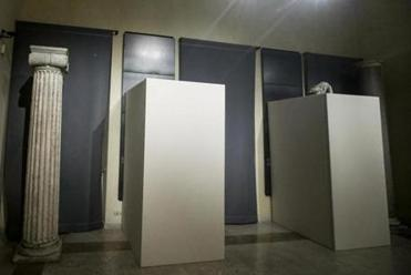 In this photo taken on Monday, Jan. 25, 2016, wooden panels cover statues inside the Rome's Capitoline Museums. A decision by Italian officials to cover up ancient nude statues to not offend Iran's visiting president is drawing ridicule in Rome. Ahead of a press conference Monday with Premier Matteo Renzi and Iranian President Hassan Rouhani, wooden panels were erected around some Roman statues in Rome's Capitoline Museums. The museum says the premier's office wanted the statues along Rouhani's path to the press conference covered up. Renzi's office declined to comment. (Giuseppe Lami/ANSA via AP)